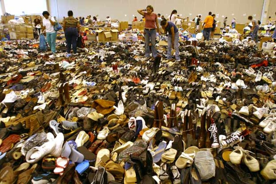 Volunteers seem a bit overwhelmed as they sort through the thousands of shoes donated to evacuees of Hurricane Katrina in the Astrodome complex in Houston, Texas. David Portnoy/Getty Images