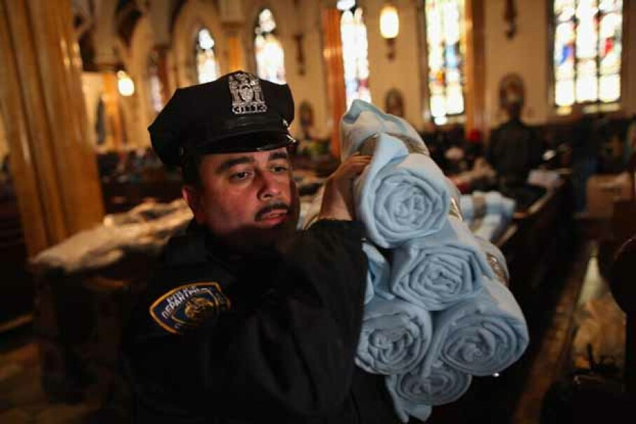 A policeman carries blankets donated by Ikea for people affected by Superstorm Sandy. Most blanket donations come from suppliers or businesses. John Moore/Getty Images