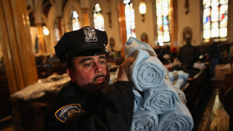 policeman, blankets, superstorm sandy