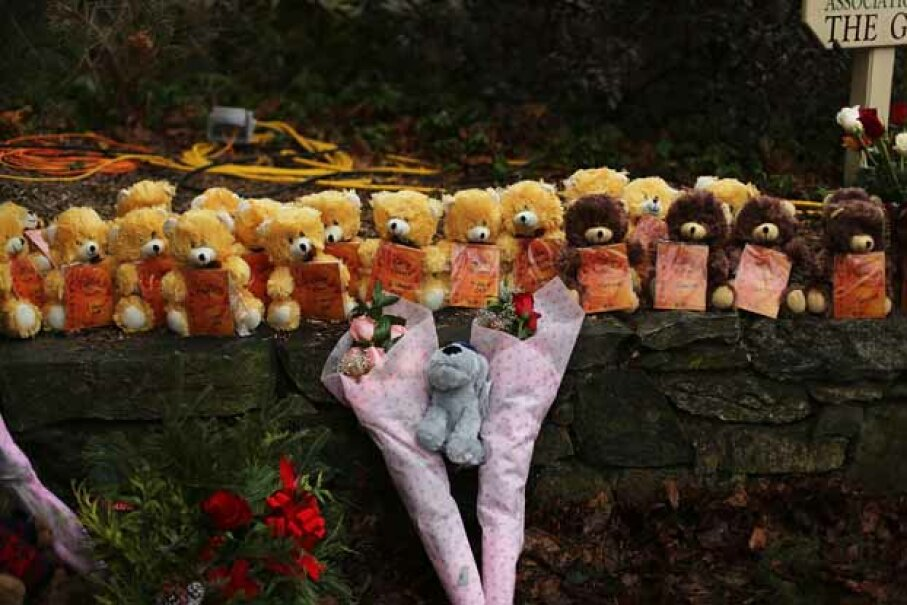 A line of teddy bears and flowers left at a memorial down the street from Sandy Hook Elementary in Newton, Conn. in memory of those killed at the school. Spencer Platt/Getty Images