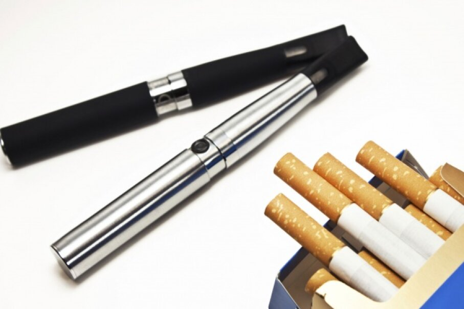 Smokers may make the switch to e-cigarettes in the hopes of saving cash. ©Santje09/iStock/Thinkstock