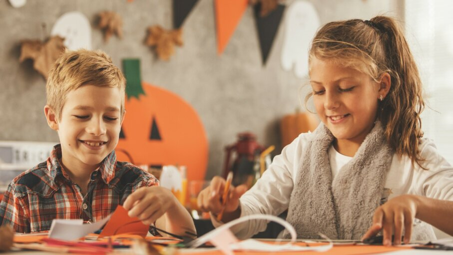 Kids doing Halloween crafts