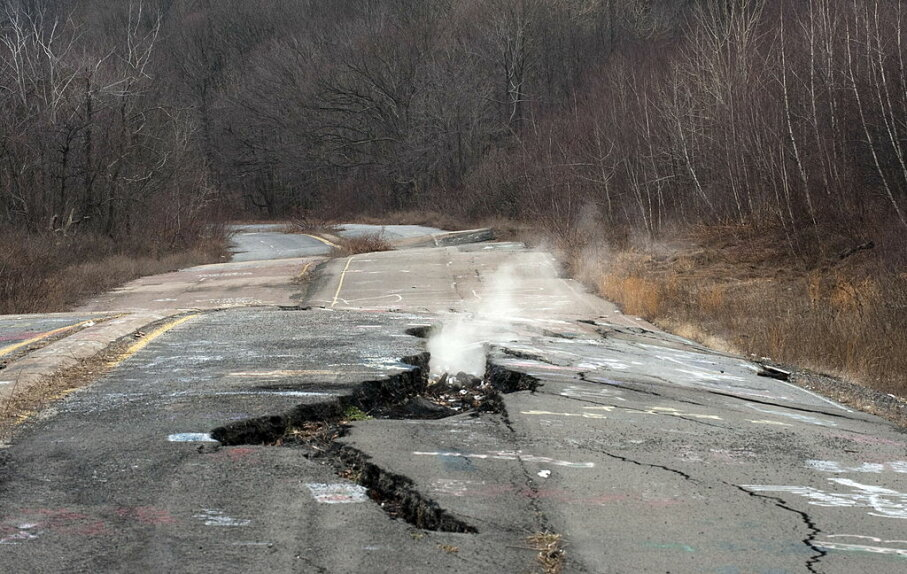 Smoke rises from a large crack in PA Highway 61, caused by the underground coal fire which has been burning for more than 50 years in Centralia, Pennsylvania. DON EMMERT/AFP/Getty Images