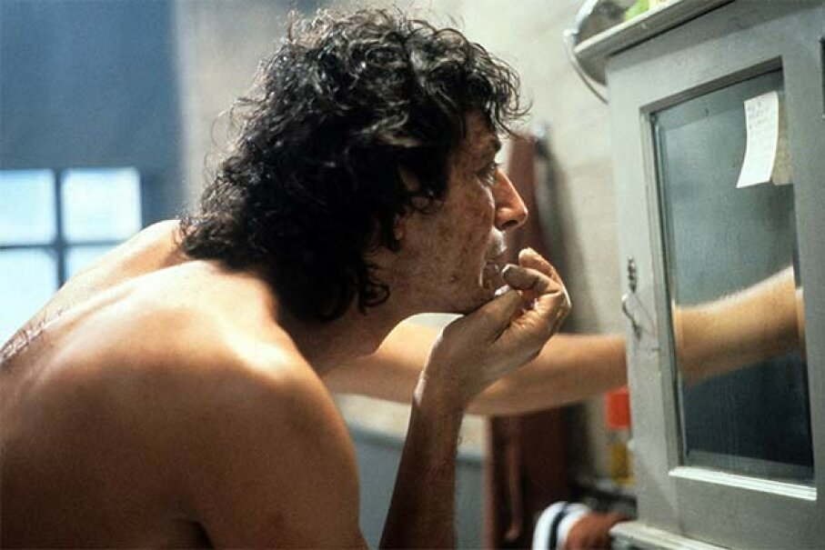 Jeff Goldblum checks out his bumpy skin in a scene from the film 'The Fly.' 20th Century-Fox/Getty Images