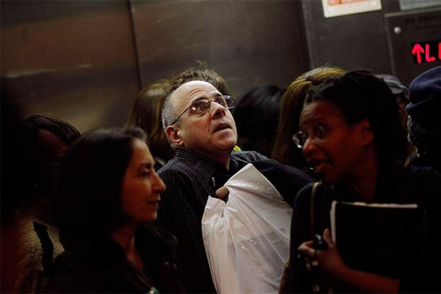 Is this your idea of elevator Hell? Make it better with our elevator etiquette tips. Chris Hondros/Getty Images