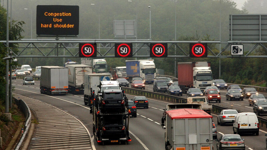 A sign instructs motorists on a British highway to drive on the road shoulder when traffic is congested. Some places in the U.S. also allow this practice. David Jones - PA Images/PA Images via Getty Images