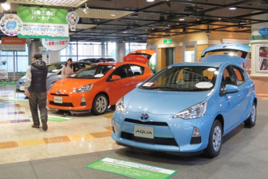 Toyota's Prius was the first hybrid car commercially available. Here, Toyota shows off the Aqua -- a hybrid gasoline-electric subcompact hatchback -- at the company's show room in Tokyo on May 8, 2013.  © KAZUHIRO NOGI/AFP/Getty Images