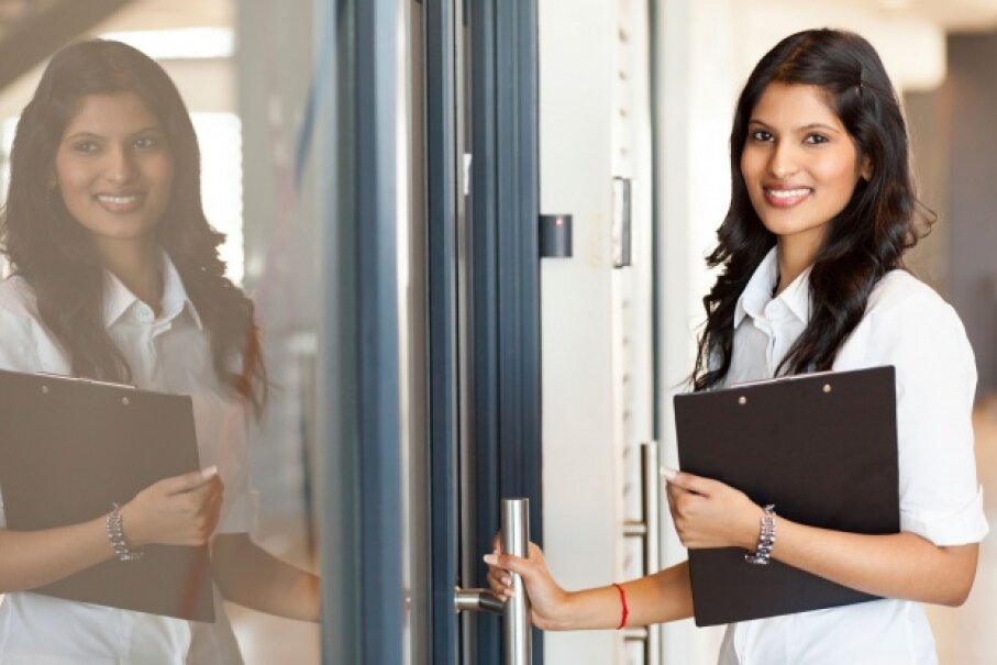 No matter who you are, it's good manners to hold the door for the person behind you. © michaeljung/iStockphoto
