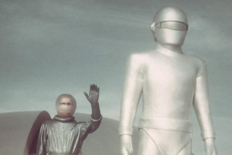 "Klaatu (left) and Gort (right) emerge from their spacecraft in a promotional still from the 1951 film ""The Day The Earth Stood Still."" Hulton Archive/Getty Images"