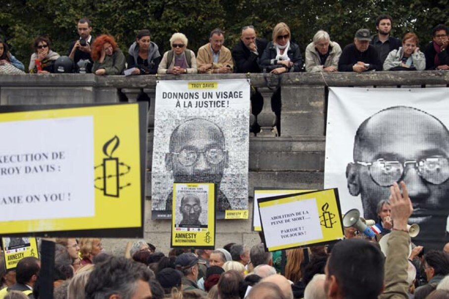 Protestors hold placards of rights group Amnesty International during a demonstration in Paris, in support of Troy Davis (featured on the posters). PIERRE VERDY/AFP/Getty Images