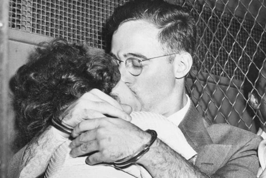 Bound for separate cells, handcuffed Julius Rosenberg and his wife, Ethel, share a fervent kiss in a prison van outside Federal court after arraignment on atomic spy charges in 1950. © Bettmann/CORBIS