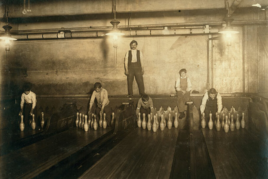 These pin boys were photographed at 1 a.m. in 1910, setting up pins in a Brooklyn bowling alley for $2 or $3 a week. Lewis Hines/Library of Congress