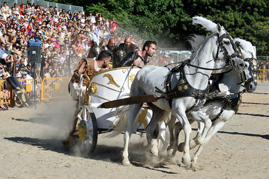 The Arde Lucus festival in Lugo, Spain celebrates the  Gallaecian-Roman heritage of the city. Here people participate in a recreation of a chariot race. Luis Díaz Devesa/Getty Images