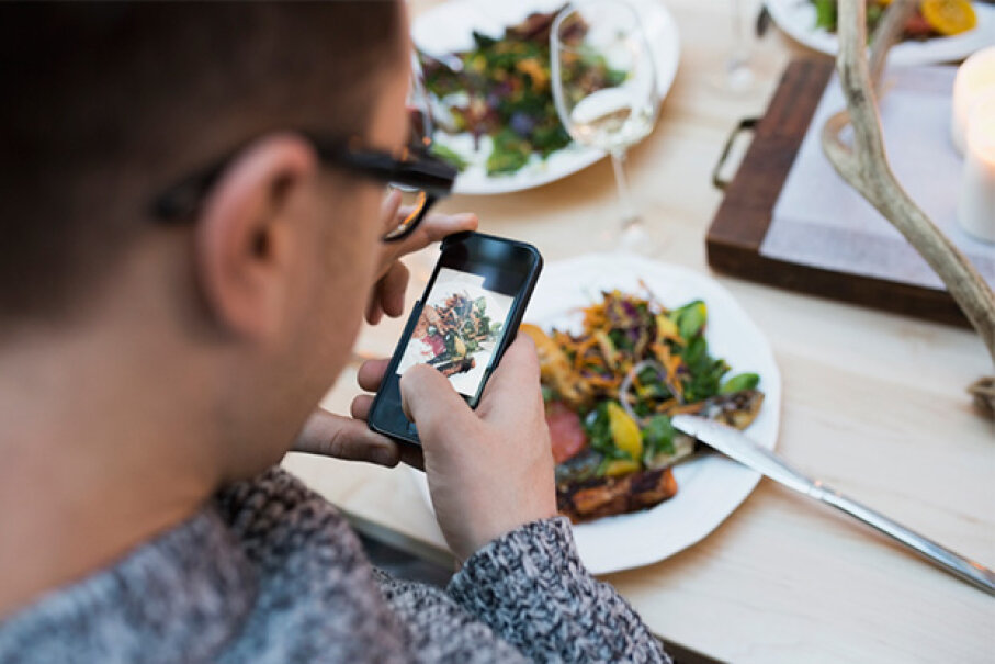 Do you really need to post a picture of your meal — and a second post about how delicious it was? Hero Images/Getty Images
