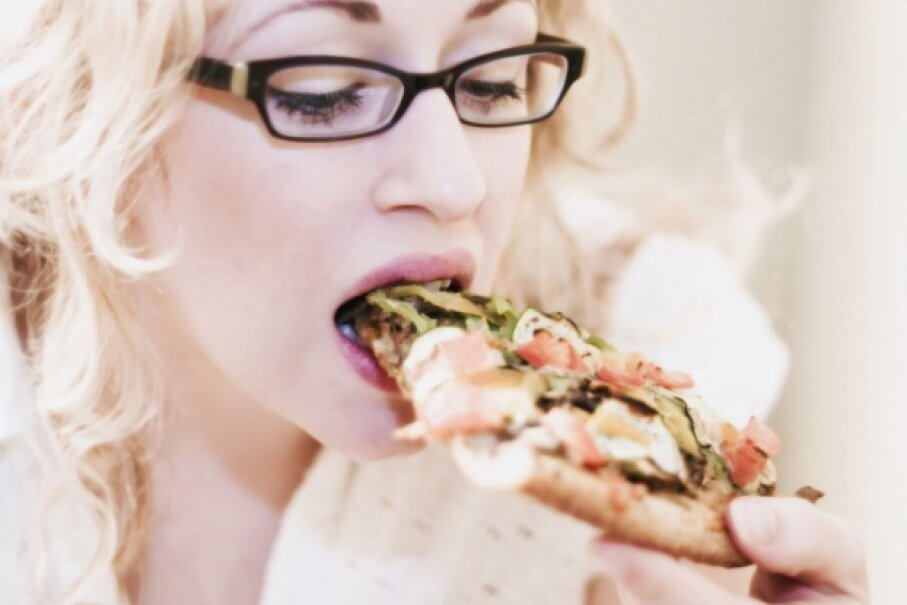 If you had to chew your pizza until it completely liquefied, you would probably eat less of it. Even so, Fletcherizing is an extreme way to approach eating.  ©Design Pics/Thinkstock