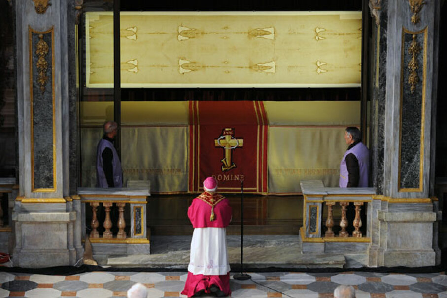 The Shroud of Turin on display in the Turin Cathedral on March 30, 2013. While the authenticity of the shroud is still debated, the relic still holds religious significance for many Catholics. ©ALESSANDRO DI MARCO/AFP/Getty Images
