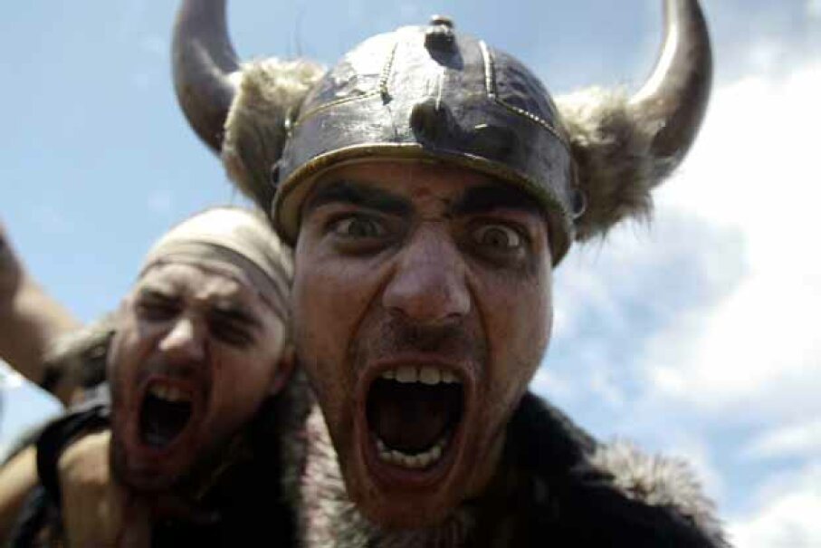Men dressed up (rather inaccurately) as Vikings take part in the annual Viking festival of Catoira in north-western Spain. © MIGUEL VIDAL/Reuters/Corbis