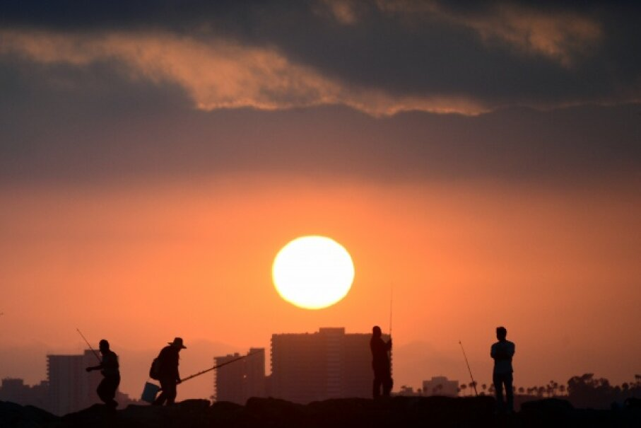 The sun prepares to set on June 28, 2014. The photo was taken at California's Seal Beach, which experiences summer from June through September, thanks to the angle of the sun's rays hitting Earth. Frederic J. Brown/AFP/Getty Images