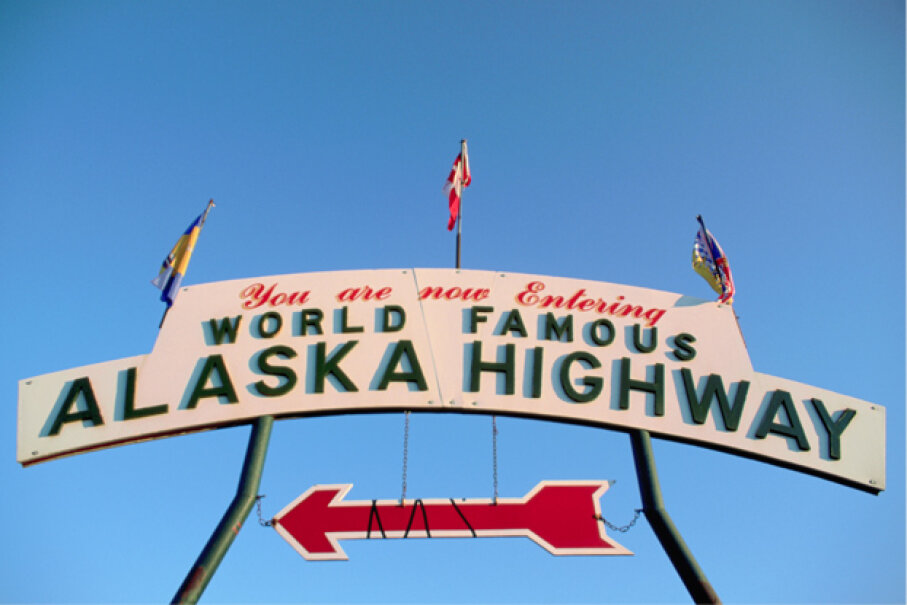 It's all blue skies in this sign from the Alaska Highway, but the making of it was backbreaking labor, and more than two dozen men died. © Patrick Bennett/CORBIS