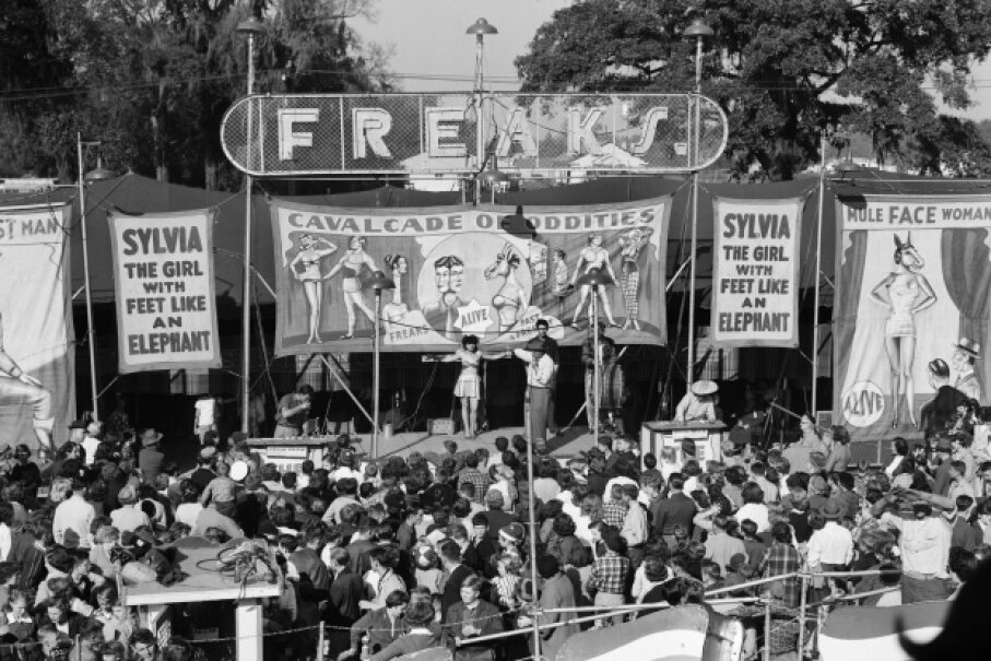 Over the years, sideshows have drawn large crowds, like this one in the 1950s. © C. S. Bauer/ClassicStock/Corbis