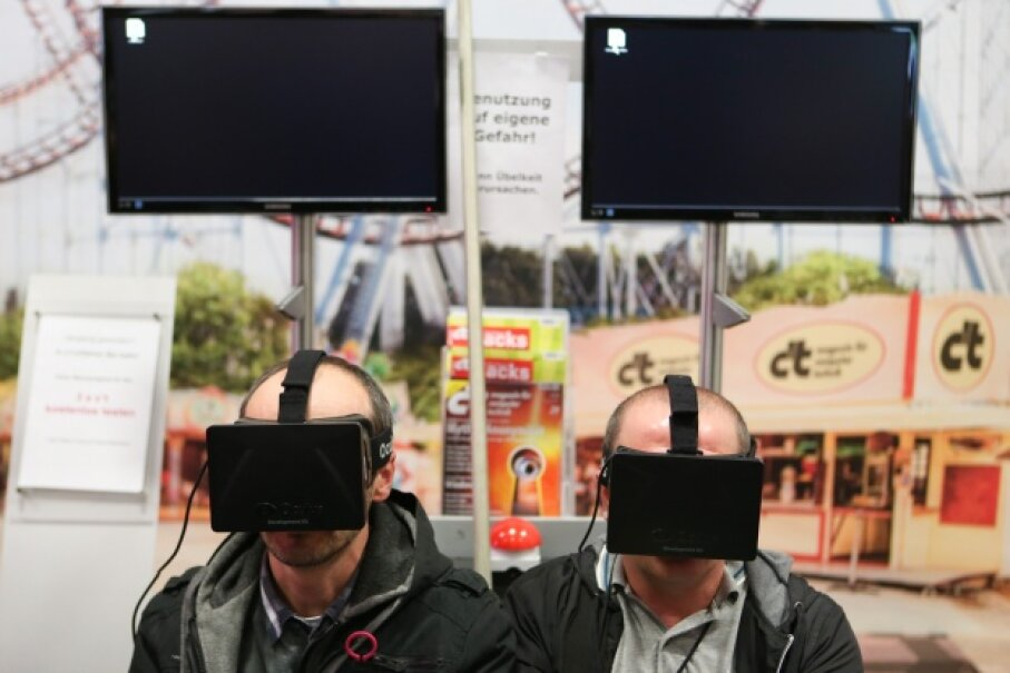 These guys happily try out the Oculus Rift virtual reality headsets during the 2013 IFA electronics trade fair in Berlin, Germany. What do such innovations say about the arrival of the technological singularity? © Zhang fan/Xinhua Press/Corbis