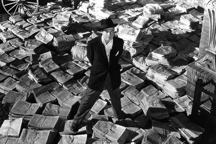Orson Welles wrote, directed and starred in 'Citizen Kane' -- and pioneered a time-distorted narrative as well as the use of lighting to capture mood. RKO Radio Pictures/Getty Images