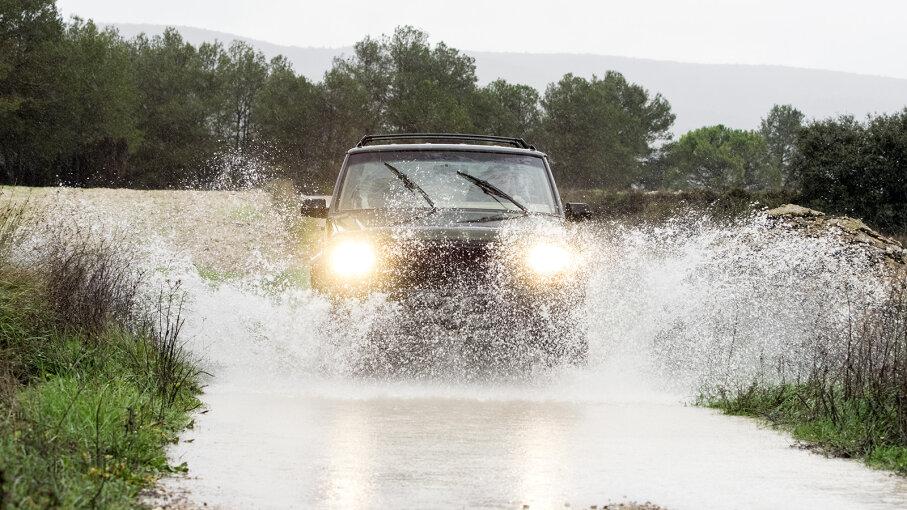 Car driving through water