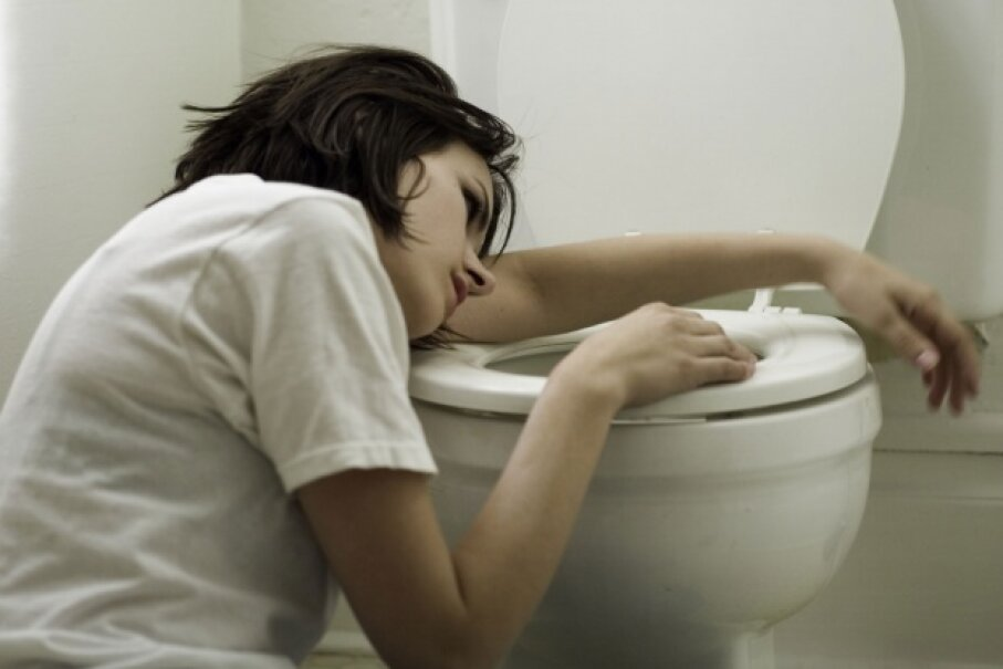Vomiting is NOT a symptom of the flu. So if you're sick to your stomach, you could have norovirus. © Photodisc/Thinkstock