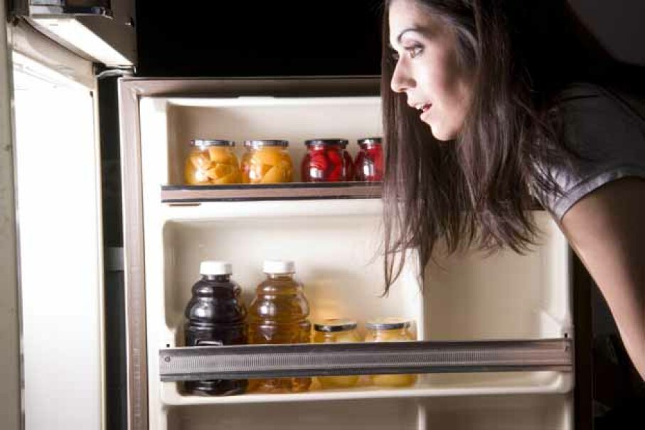 Something to make you feel better about late-night snacking: It's no worse than snacking during the day. iStockphoto/Thinkstock
