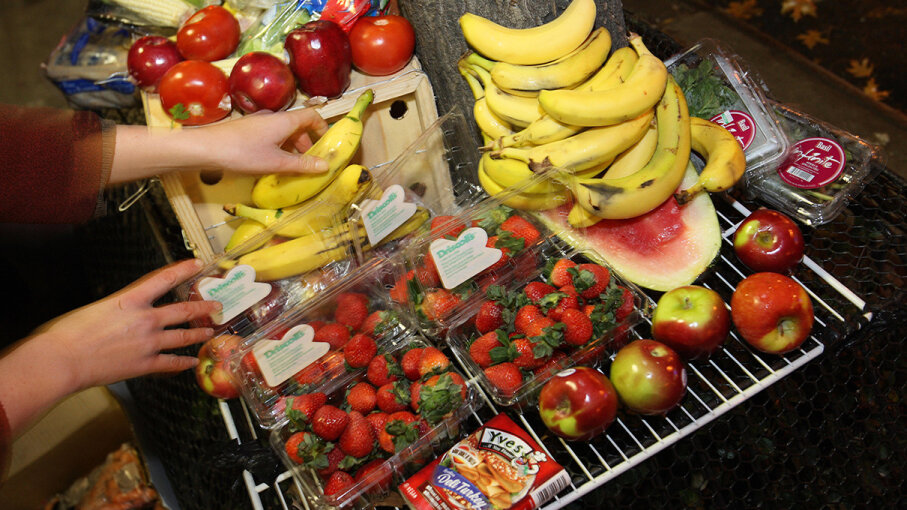 In New York City, perfectly good apples, bananas, strawberries and other food are tossed in the trash with garbage.  DON EMMERT/AFP/Getty Images