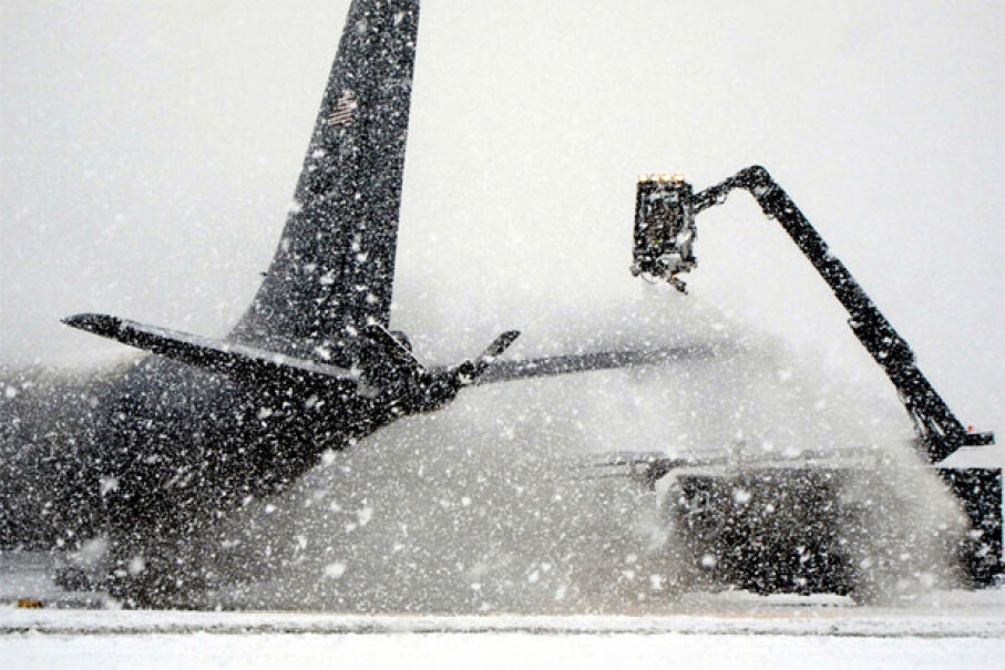 A deicer clears snow off a KC-135 Stratotanker before it takes off from Manas Air Base, Kyrgyzstan, bound for Afghanistan. Image courtesy U.S. Air Force/Tech. Sgt. Matthew McLean
