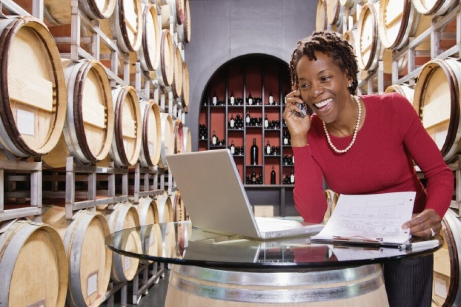 Wine probably tastes even better when you're being paid to make it. © ColorBlind Images/Corbis
