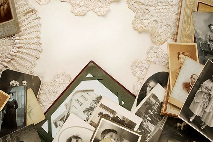 Rather than inserting the original photos in your scrapbooks, use high-resolution copies and keep the originals in acid-free archival boxes. Michaela Stejskalová/iStock/Thinkstock