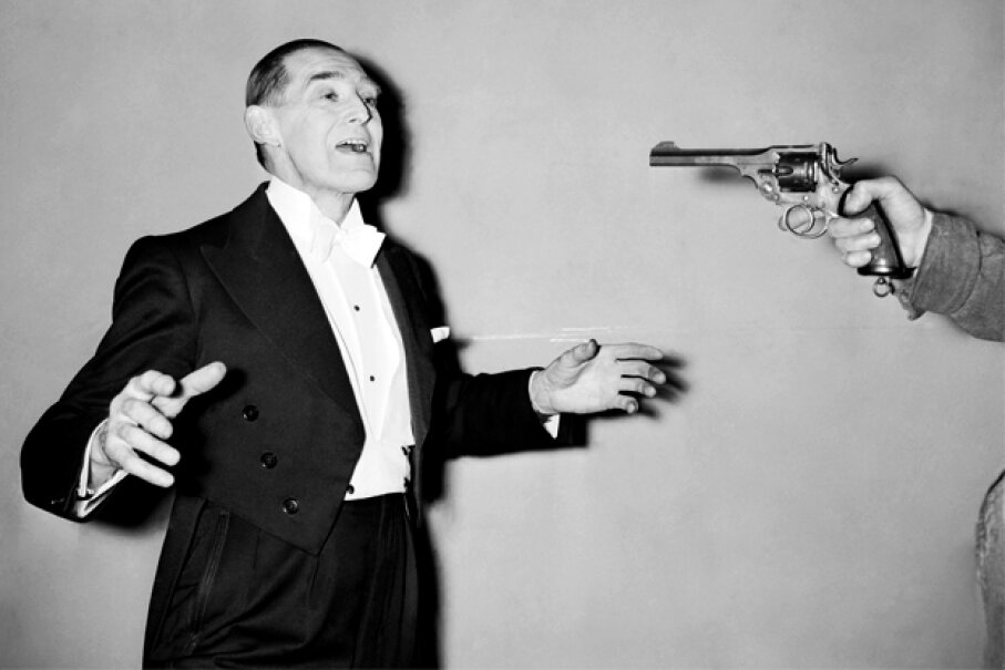 Magician George Grimmond performs a bullet catch trick in 1958 similar to the one that killed Madame DeLinsky 138 years earlier. © Bettmann/Corbis