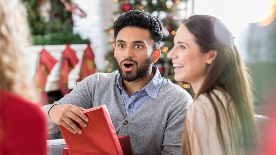 man opening Christmas gift