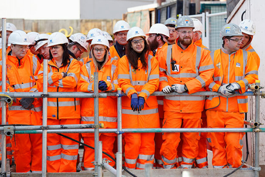 Construction workers, including three females in the front, await the arrival of Queen Elizabeth II for a visit to the Crossrail station site at Bond Street, London, in 2016. Women make up just 3 percent of U.S. construction workers. Max Mumby/Indigo/Getty Images