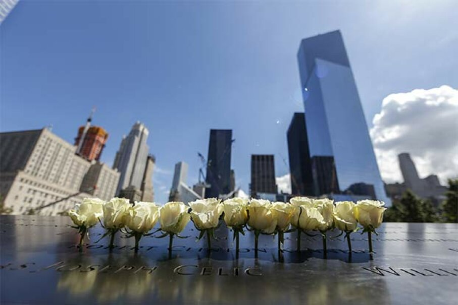 Relatives of the victims of the 9/11 attacks leave flowers, toys and photos on the names written on the monument at the National September 11 Memorial & Museum in New York. Bilgin Sasmaz/Anadolu Agency/Getty Images
