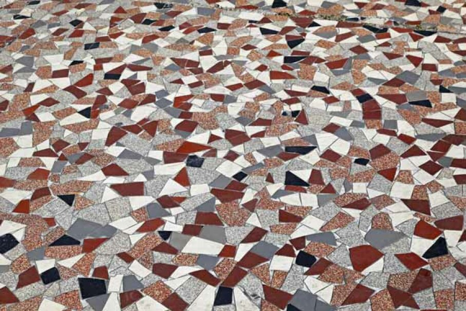 Terrazzo is crushed-up stone and glass, held together with a binding agent. The countertop is then buffed for a nice smooth surface. iStock/Thinkstock