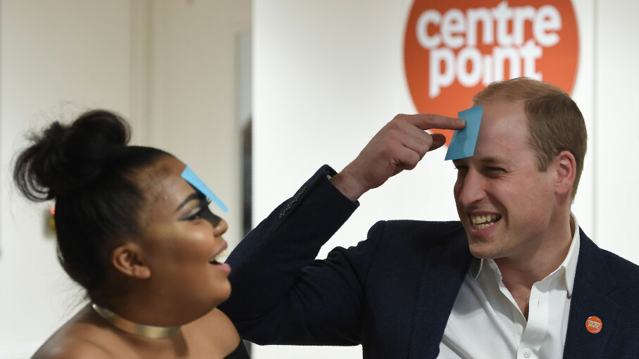 Britain's Prince William reacts as he plays a guessing game with 22-year-old Sherihan Sharis, during his visit to a Centrepoint hostel in London on Jan. 10, 2017. Centrepoint is a charity for homeless youth. EDDIE MULHOLLAND/AFP/Getty Images