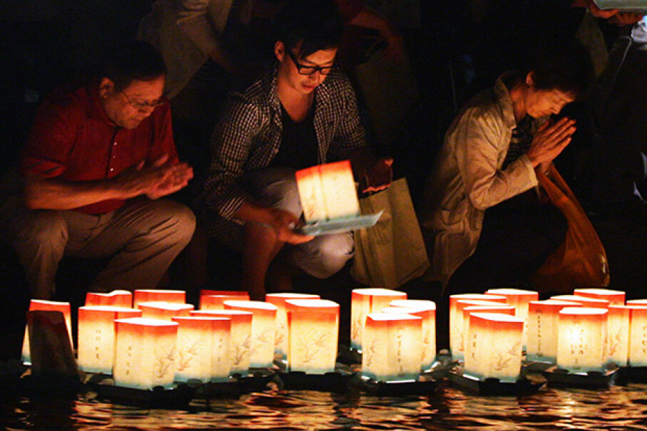 People float lanterns to guide the spirits back to their real homes during the Obon Festival, Fukui, Japan in 2011. Buddhika Weerasinghe/Getty Images