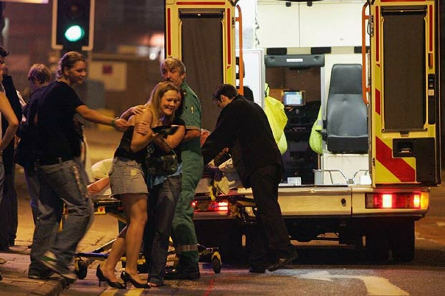 Emergency responders help a clubber into an ambulance to accompany her friend to hospital after the friend collapsed in a club in Bristol, England. Matt Cardy/Getty Images