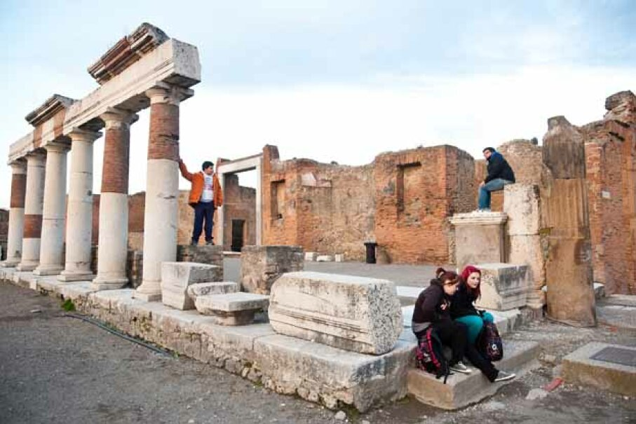 Tourists visit the ruins of the Foro (Forum) at the archeological site in Pompei, Italy. Pompeii was buried in 79, discovered in the 1590s, and rediscovered in the 1700s. Giorgio Cosulich/Getty Images