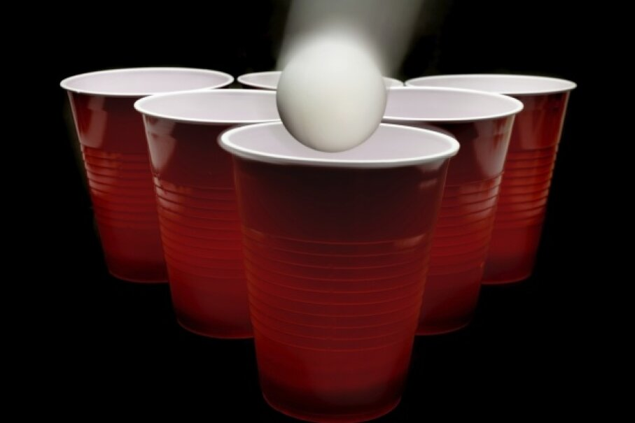 Beer pong: Silly college game and efficient vehicle for transferring bacteria? iStockphoto/Thinkstock