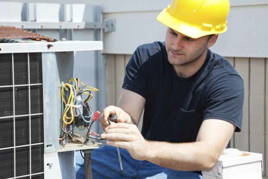 Have a HVAC technician come to your house in summer and winter to service your air conditioner and furnace. Lisa F. Young/iStock/Thinkstock
