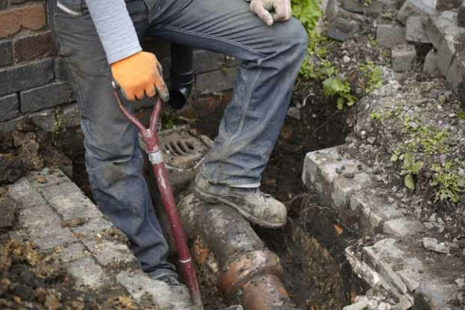 The major costs with a broken sewer line are not with repairing the line, but with replacing the driveway and relandscaping the yard afterwards. ezza116/iStock/Thinkstock
