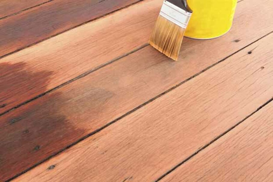 After scrubbing down your deck, give it 48 hours to dry before applying a stain and/or resealant. Pat Glover/iStock/Thinkstock