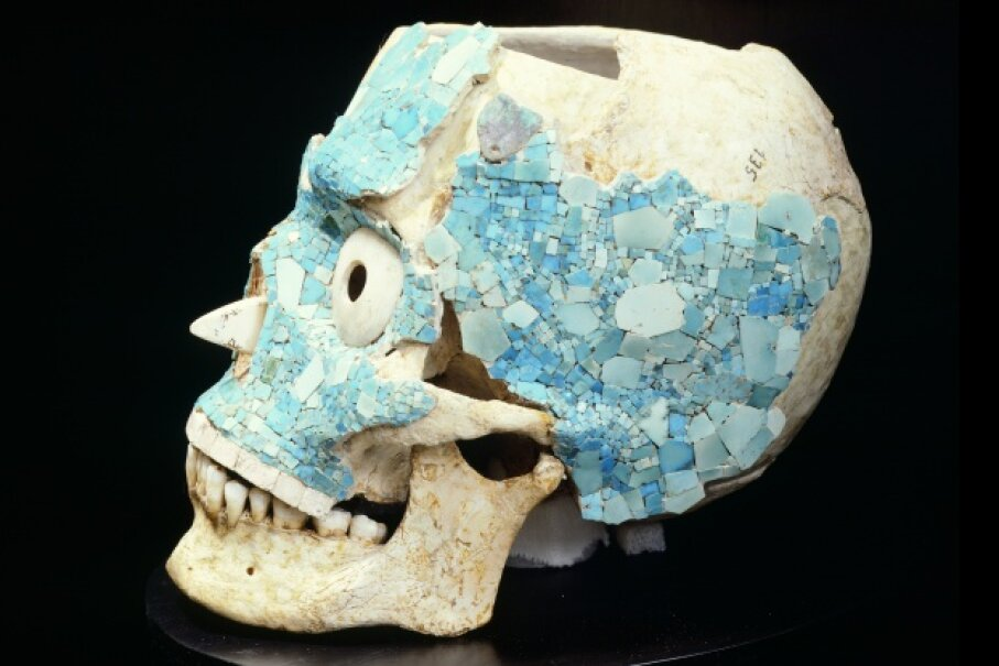 A skull decorated with turquoise salvaged from the treasury of Tomb 7 in Monte Alban, Mexico, now rests at the Museo De Las Culturas De Oaxaca. Caso was integral to discovering and excavating the tomb. DeAgostini/Getty Images