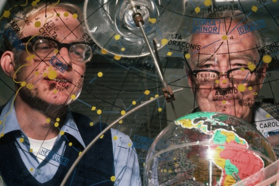 Father-and-son research team Luis and Walter Alvarez peer through a star dome, which shows the orbit and location, relative to Earth, of stars and constellations. The Alvarezes postulated that a giant asteroid or comet hit Earth millions of years ago, causing mass extinctions. © Roger Ressmeyer/Corbis