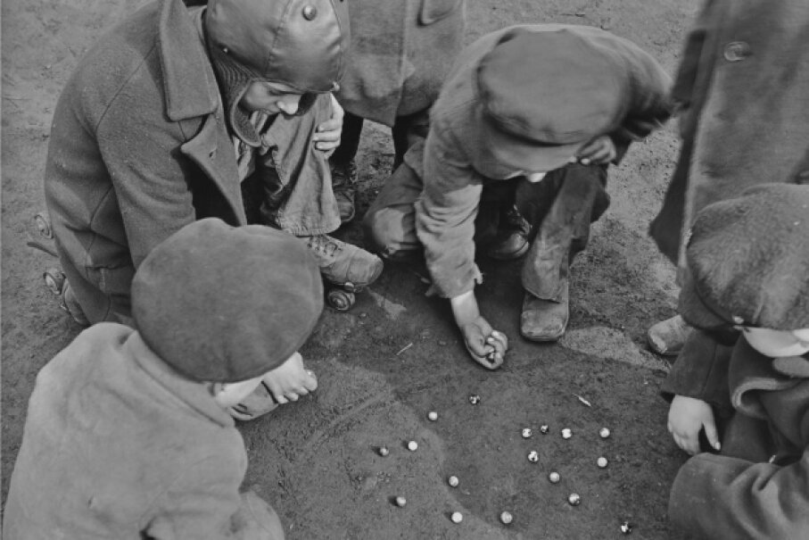 The lucky winner of a game of marbles can walk away with more marbles than he came with if he's playing for keeps.  Keystone View Company/FPG/Archive Photos/Getty Images