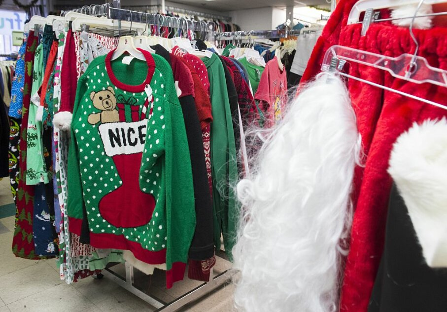 Ugly Christmas sweaters are for sale at the Frugalista second-hand store in Washington, D.C. While the only crime these garments have committed is against good taste, other holiday sweaters have gotten into trouble for their messages. SAUL LOEB/AFP/Getty Images